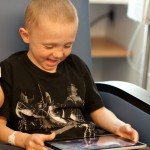 Pediatric Patient Enjoying iPad in Playroom