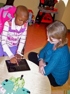 Pediatric Patient Using Her New iPad With Therapist  Bridget